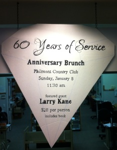 60th Anniversary event with Larry Kane sign